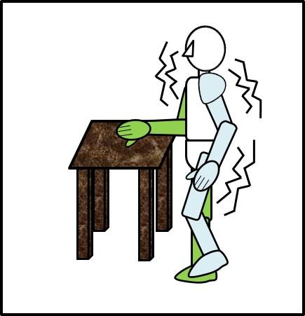 台に手をつけながら、片足でバランスを取る
